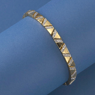 18K Gold Vermeil and Channel set Cubic Zirconia form triangles bracelet