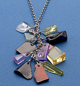 Multi-chip semi precious stones, polished with Rhodium chain and CZ Bale